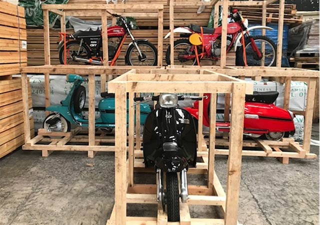 Motorbikes in pallets bound for Japan